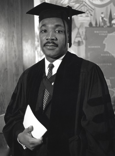 MLK Jr. at age 25 wearing his graduation robes from Boston University where he received his doctorate degree.