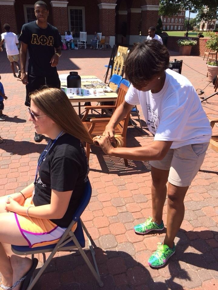 This woman generously donated 4 inches of her hair on the spot.